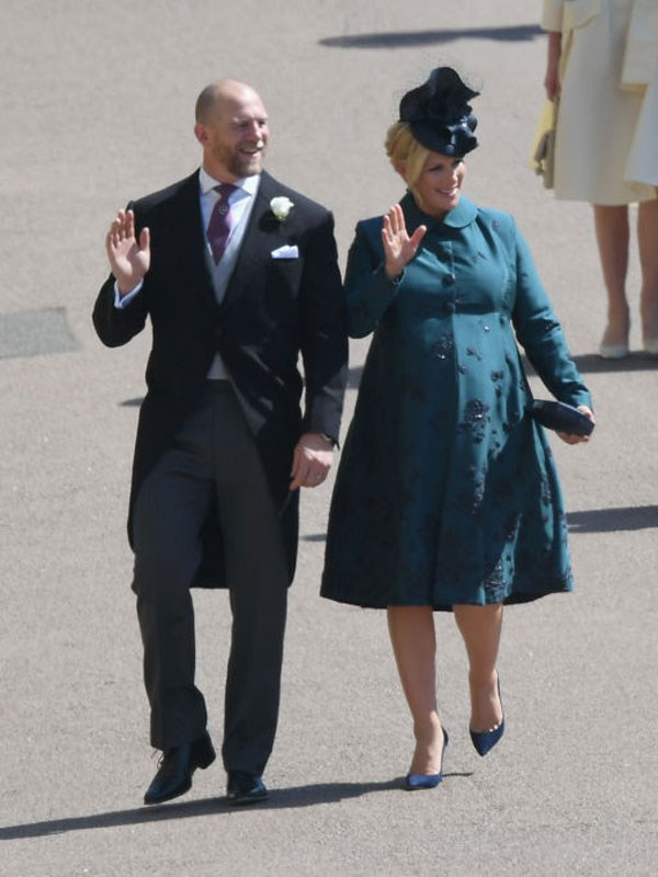 Zara and her husband Mark arrive at the royal wedding.