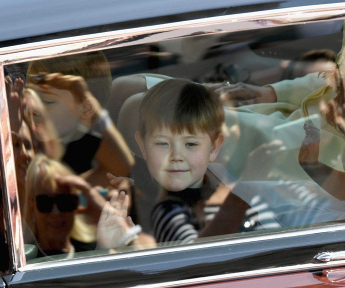 Jasper Dyer waves to crowds as he arrives at the royal wedding.