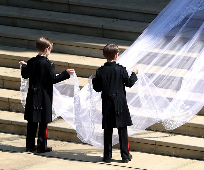 Seven-year-old twins Brian and John Mulroney help the bride with her veil.