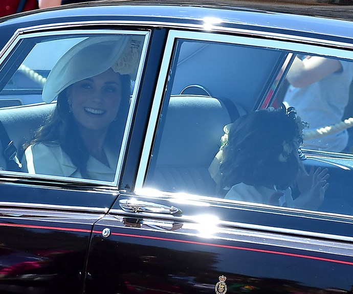 Duchess Catherine and Princess Charlotte arrive at the royal wedding.
