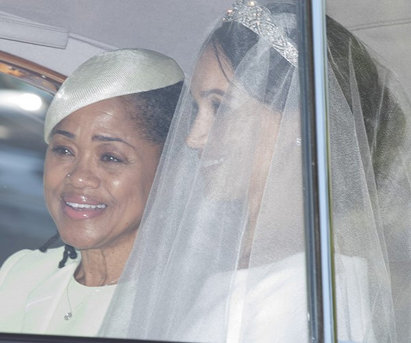 A tearful Doria arrived with Meghan.