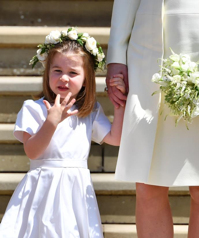 Charlotte was dressed in a classic white dress and a floral crown for the big day.