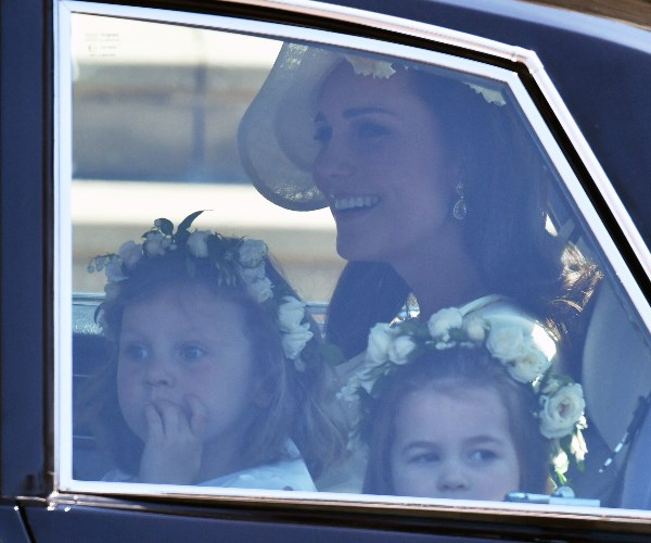 Duchess Catherine arrives to the chapel with her little daughter, Charlotte, and another bridesmaid.