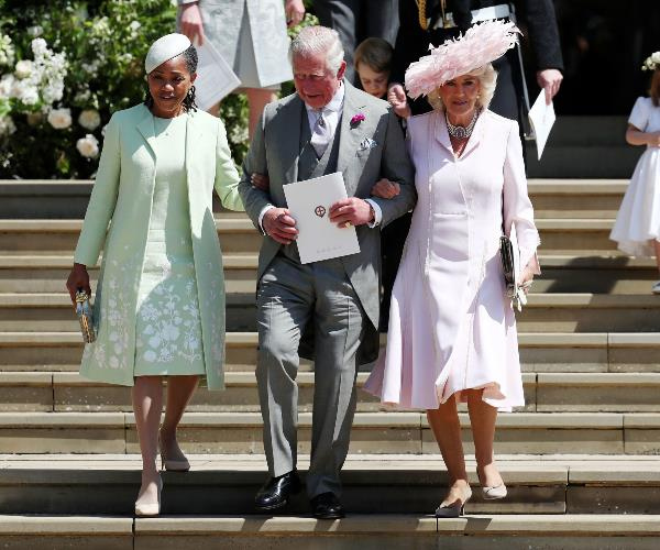 The in-laws! Charles and wife Camilla, the Duchess of Cornwall are pictured alongside Meghan's mum Doria Ragland.