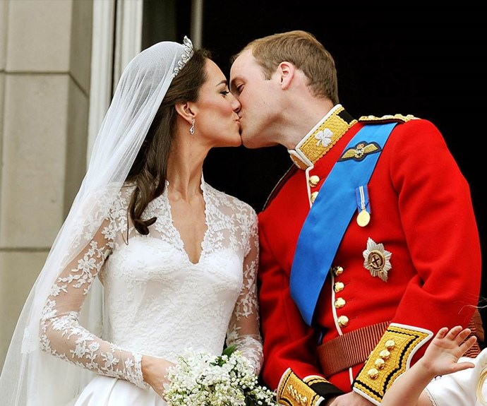 Duchess Catherine and Prince William's first kiss as man and wife at Buckingham Palace.