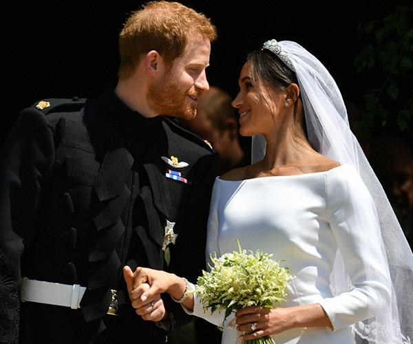 The look of love! A BBC reporter recalls meeting 'totally in love' Harry and Meghan.