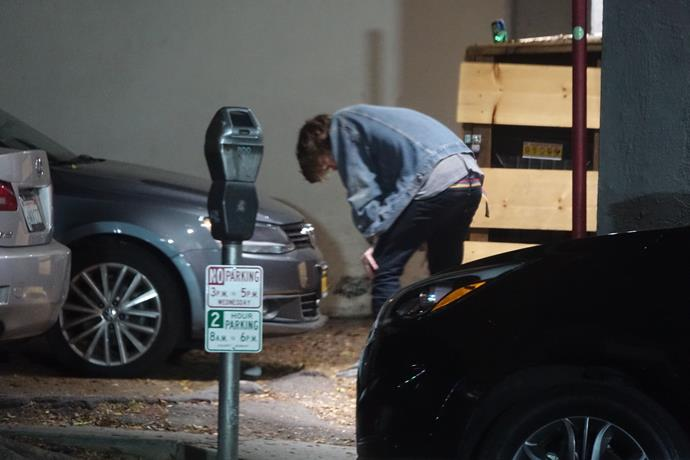 The 19-year-old was spotted rushing outside and asking for water after his performance, before vomiting on the street and nursing his head.