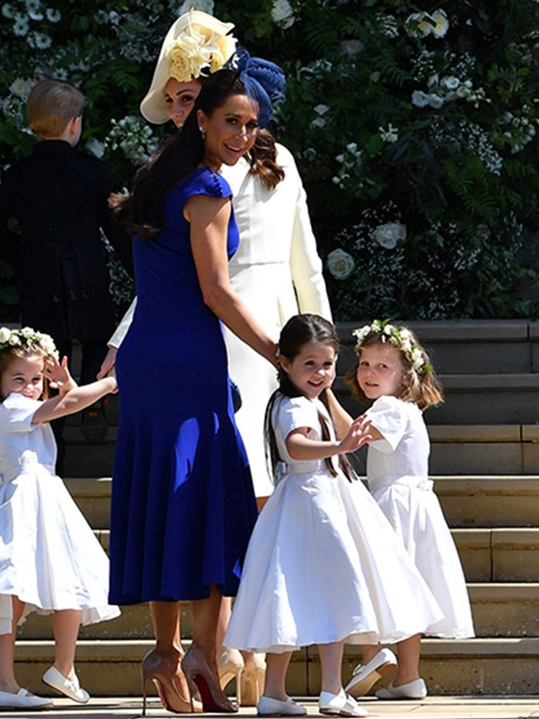 Meghan's unofficial maid of honour Jessica stunned as she arrived at the royal wedding.