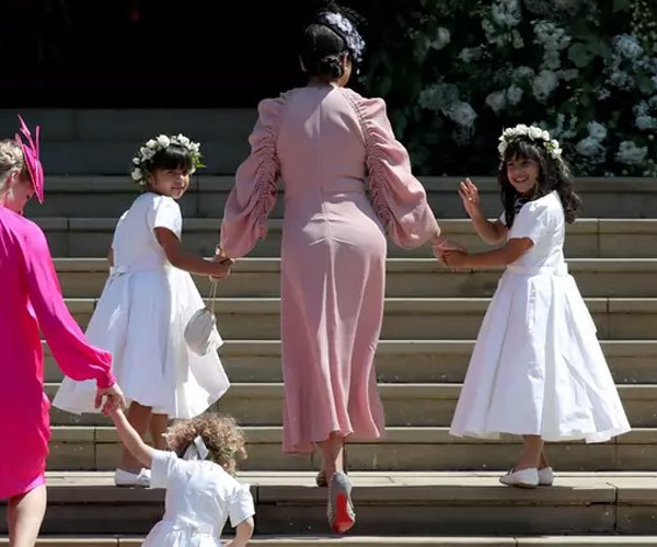 Benita's twins Rylan and Remi served as bridesmaid on their aunt Meghan's special day.