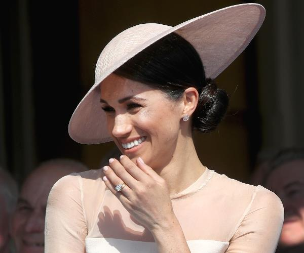 During her new-husband's speech, Meghan suffered a fit of giggles.