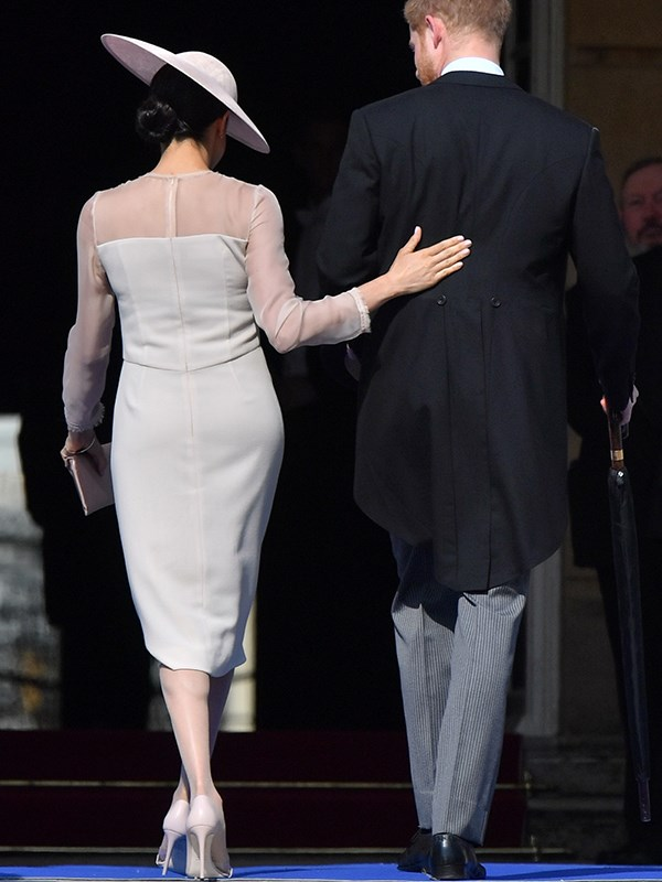 Meghan stepped out in pantyhose, thought to be a mandate of royal dressing, for the first time.