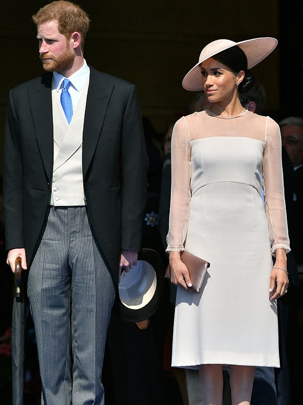 Despite taking a departure from her usual style, Meghan looked demure and absolutely gorgeous.