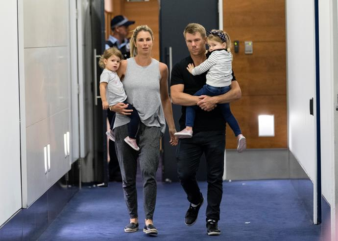 Candice, David and their young children arrive at Sydney International Airport on March 29.