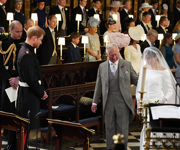 Prince Charles stepped in for Meghan's father, Thomas, at the Royal Wedding.