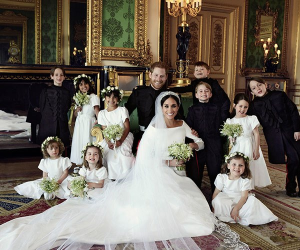 "The photographer got the bridal party to smile by asking them ""who likes smarties?"" Prince George is clearly a big fan!"