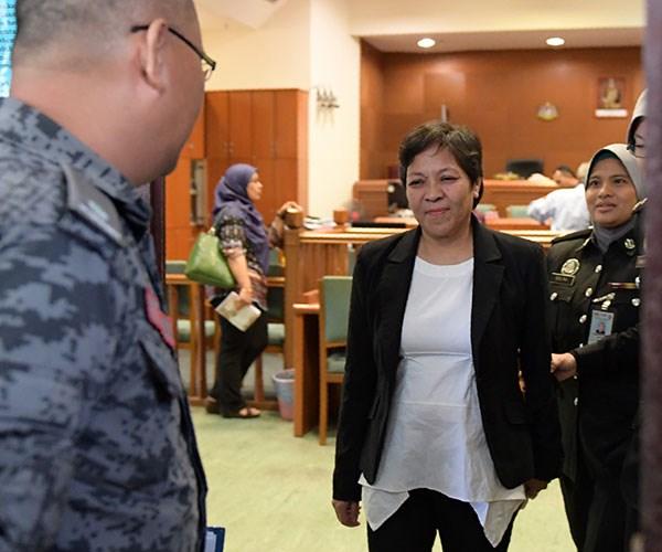 Maria Elvira Pinto Exposto leaving court.