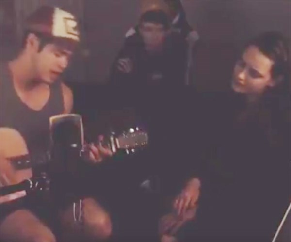 The couple jam out with a friend away from filming