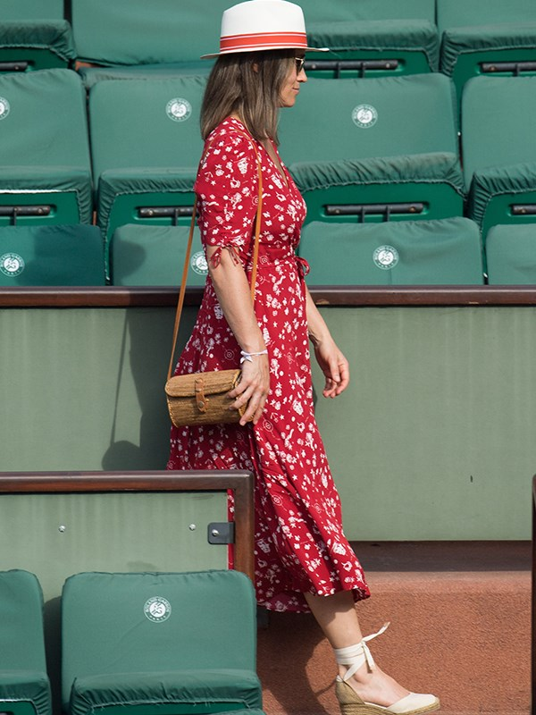 Pippa showed a tiny baby bump under a Ralph Lauren wrap dress.