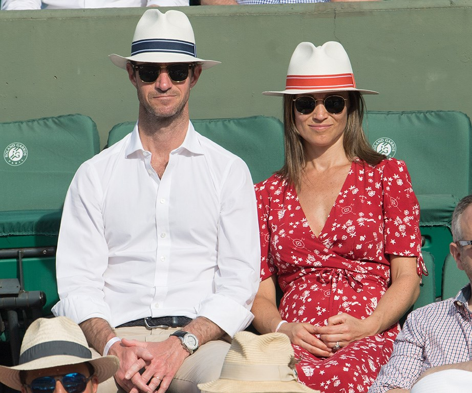 Pippa cradles her growing baby bump on a day out at the French Open.