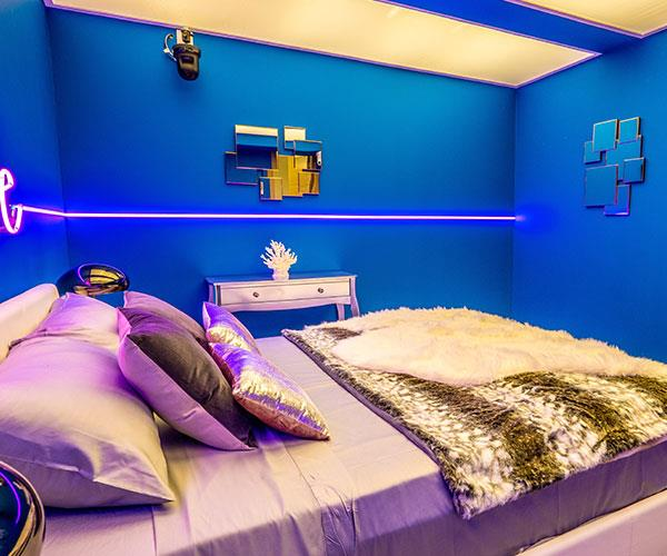The royal blue walls with the metallic sheets make for a zinging contrast.