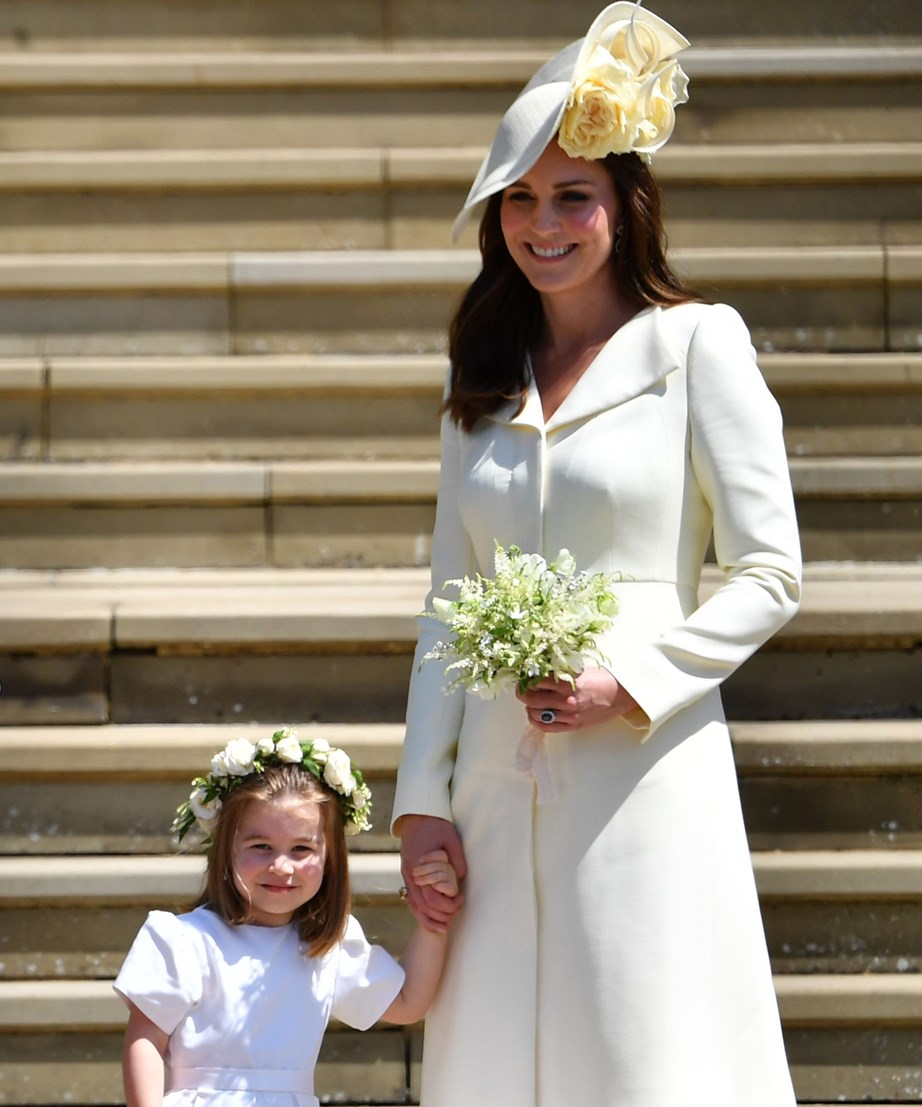 Princess Charlotte held tightly onto her doting mum's hand for much of the proceedings.