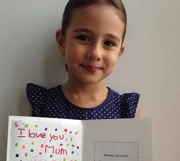 James wished ex Jess a Happy Mother's Day with this picture of Scout, holding an adorable hand-made card.