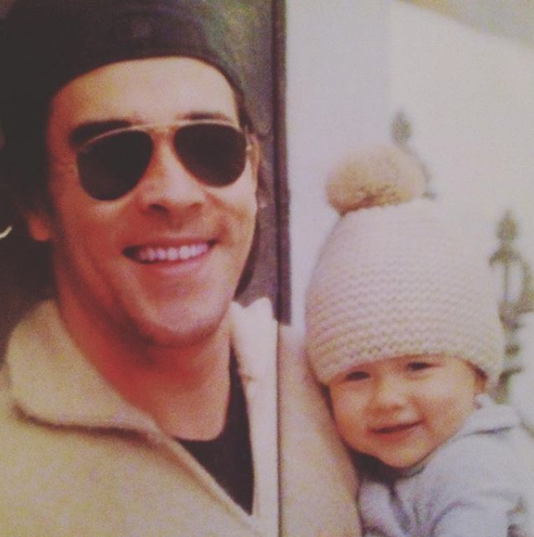 Hats? check. Adorable grins? check. James and his mini-me have been in sync from the early days!