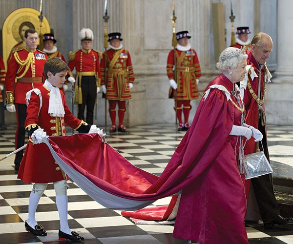 No pressure! Arthur helps The Queen with her robe in 2012.