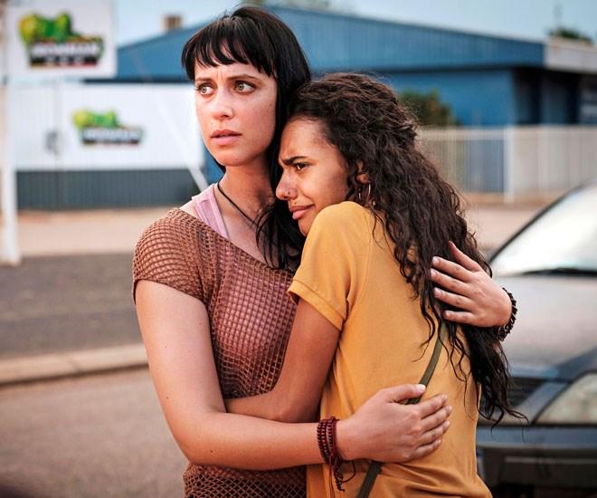 Jessica (left) stars alongside Madeleine Madden in *Mystery Road.*