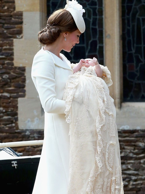 Duchess Catherine holding Charlotte at her christening.