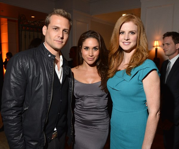 Meghan is pictured with former co-stars Gabriel Macht and Sarah Rafferty.