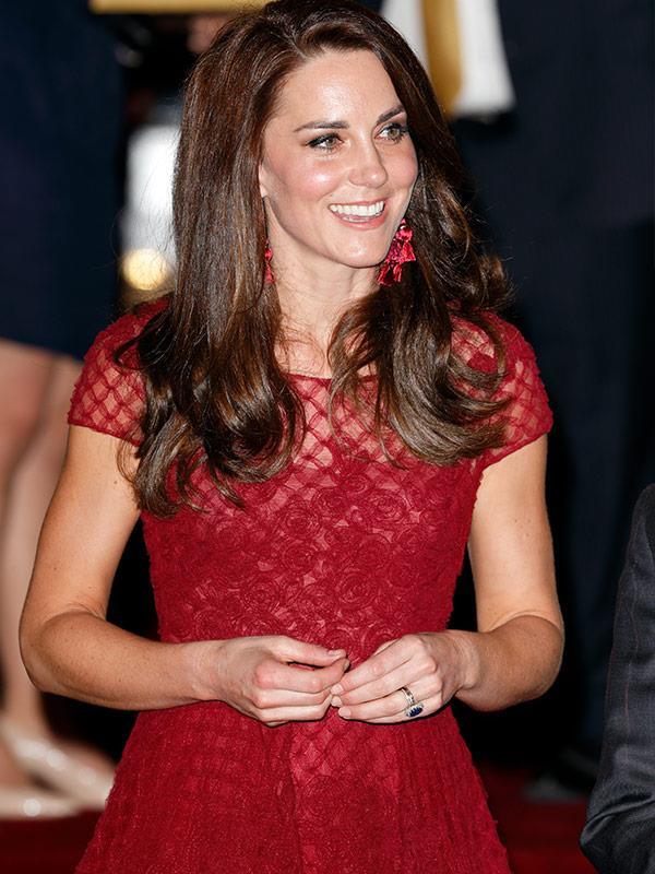 We just love the red textured earrings peeping through her brunette locks.