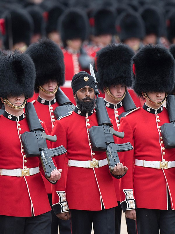 22-year-old soldier Charanpreet Singh Lall is the first person to wear a turban during the official trooping parade.