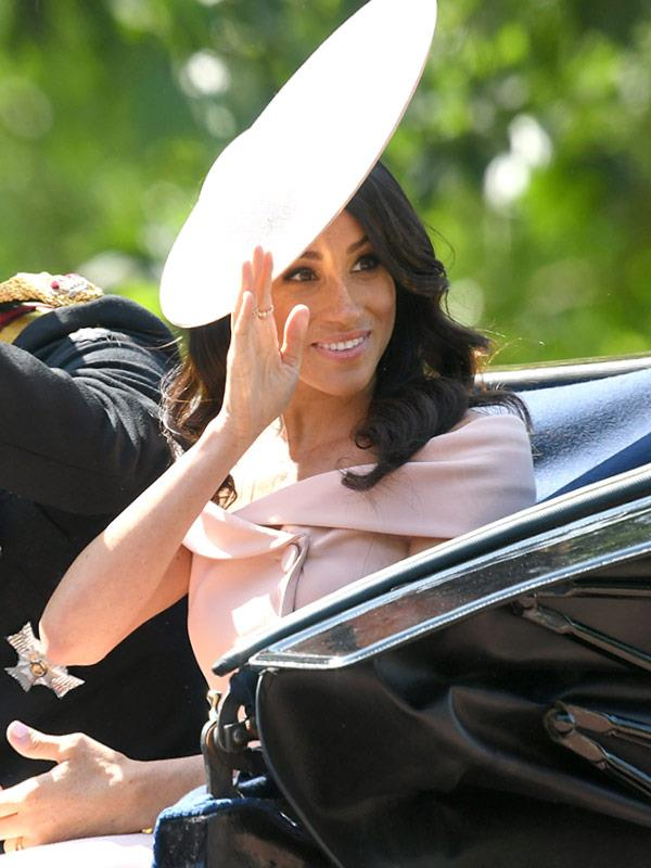 Meghan has perfected her royal wave.