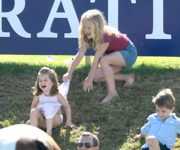 She's back! Cheeky Savannah Phillips jokes about with Princess Charlotte.
