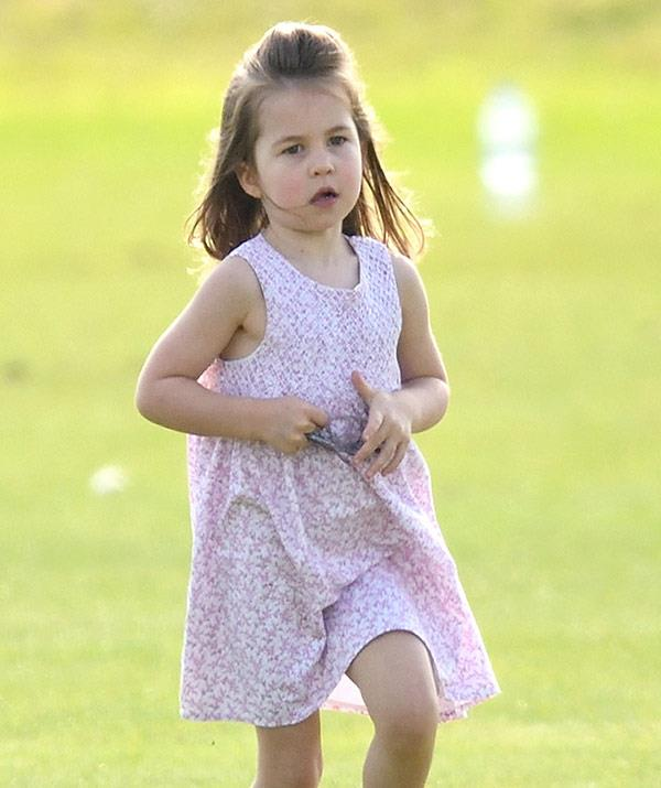 Charlotte looked adorable in a floral pink sundress.