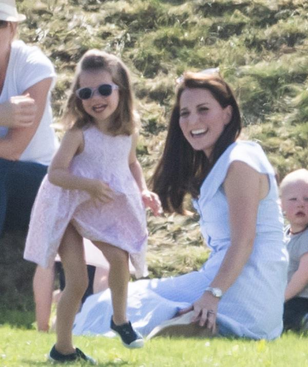 She's a rock star royal in the making! Charlotte had everyone in stitches as she joked about with a pair of sunglasses on.
