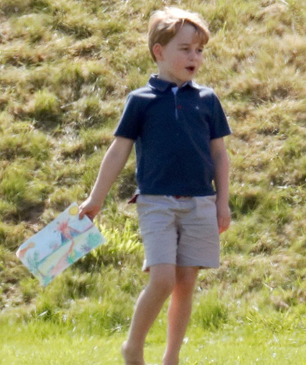 The little Prince held onto a sketch of a volcano during his day at the polo.