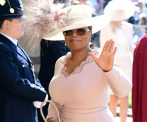 Oprah attending Meghan and Harry's wedding last year in May. *(Image: Getty)*