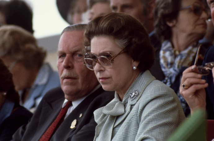 Double-trouble! The Queen was repping stylish, yet practical eyewear since before the time of bifocals. Here, the Queen wears a pair of glasses over her sunglasses in the Royal Box at the Windsor Horse Show in 1982.