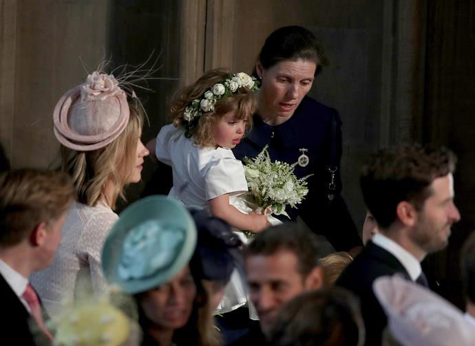 Royal nanny Maria Borrallo comforting one of Megan and Harry's crying bridesmaids, Zalie Warren.