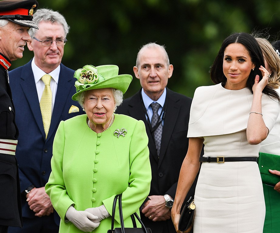 Meghan's nerves showed as she constantly reached for her hair during her first solo outing with The Queen.