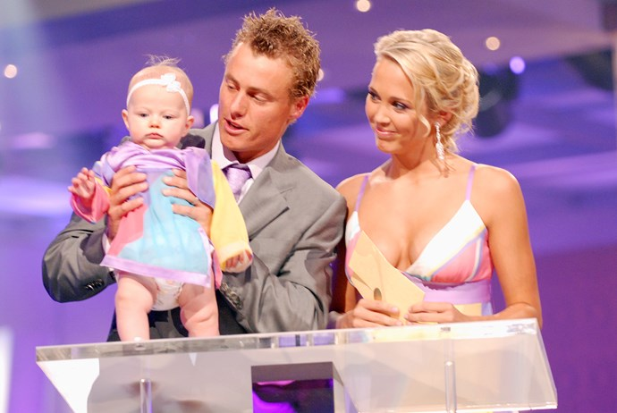**The Hewitts dress the same - and take their baby on-stage**  Bec and Lleyton Hewitt showed how to coordinate outfits when they took to the stage in 2006. Bec and baby Mia's matching gowns were perfectly in tune with Lleyon's pastel tie.