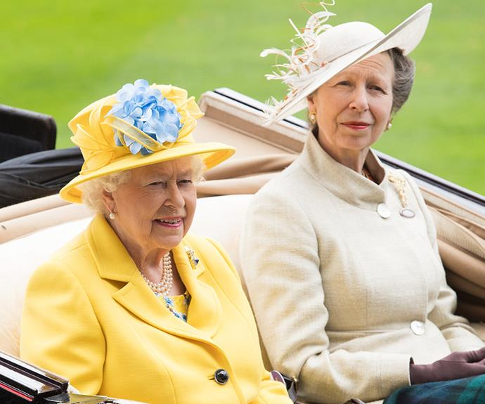 The Queen arrives with Princess Anne.