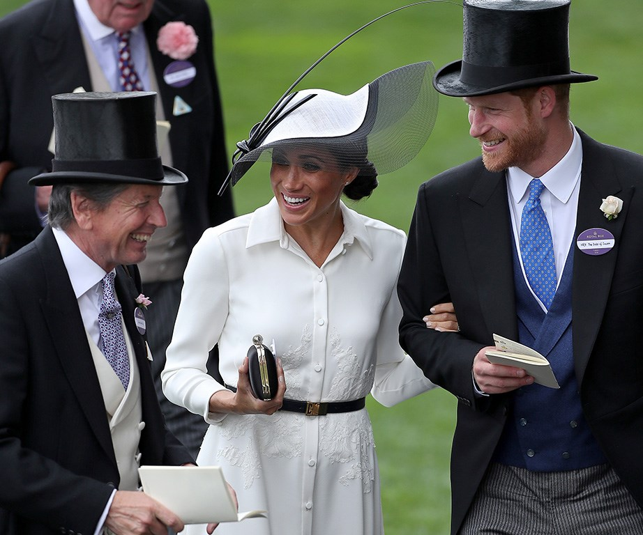 They're so happy! Meghan and Harry talk with the Queen's Bloodstock and Racing Advisor, John Warren.