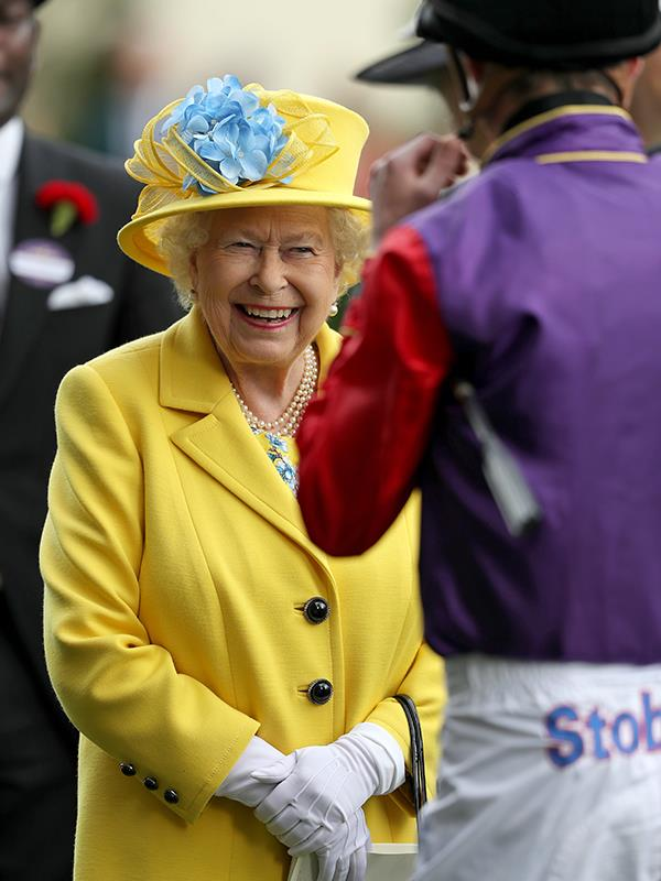 The Queen's spirits were as sunny as her dress!