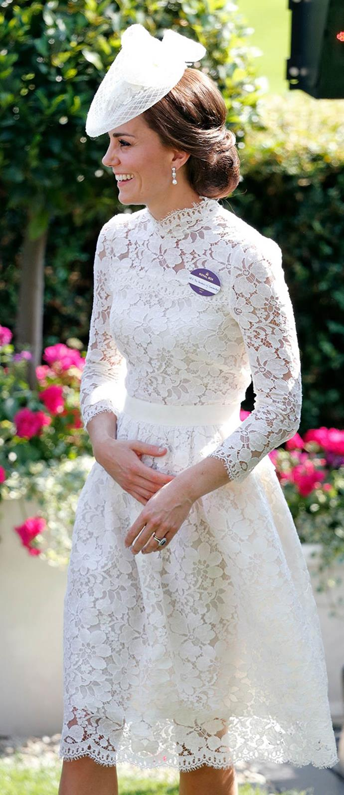 Duchess Catherine in a bespoke Alexander McQueen floral lace dress and a white topper adorned with pearls and a lace bow, at the Royal Ascot in 2017.