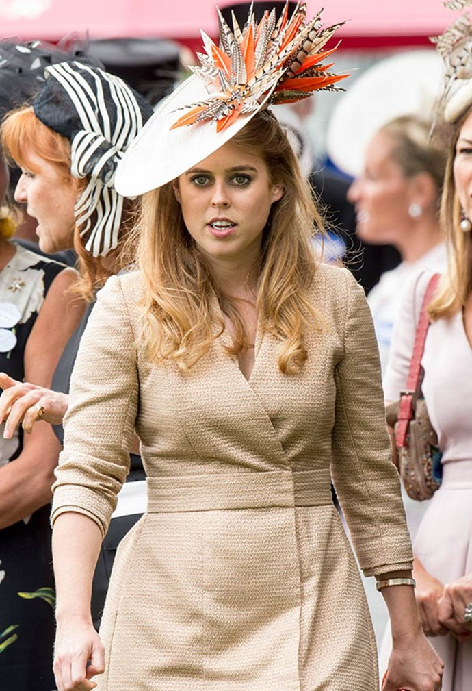 Princess Beatrice opted to top her nude coat-dress with a statement hat brimming with exotic-looking feathers, in 2017.