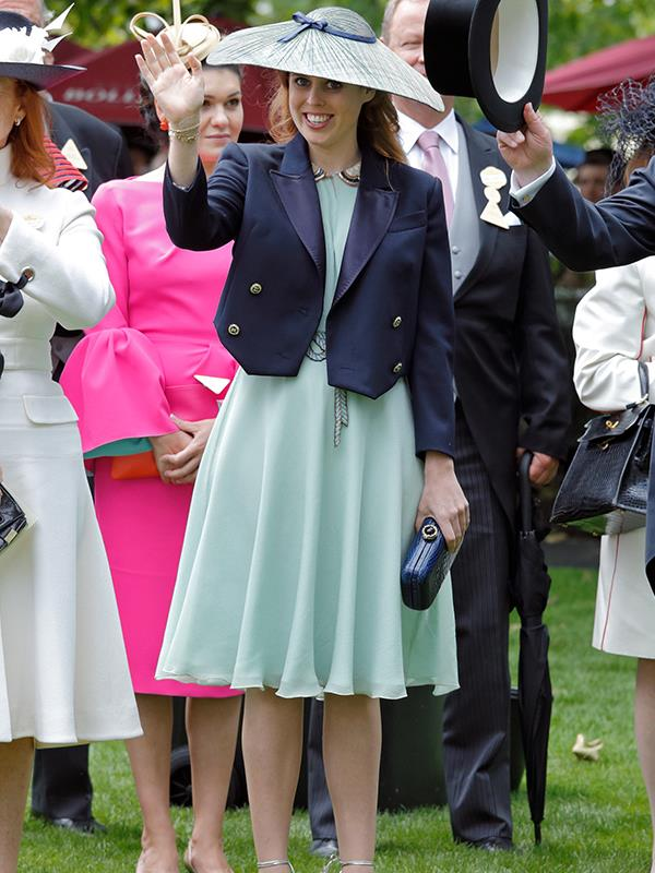 Princess Beatrice waves from underneath an interestingly shaped hat, 2016.