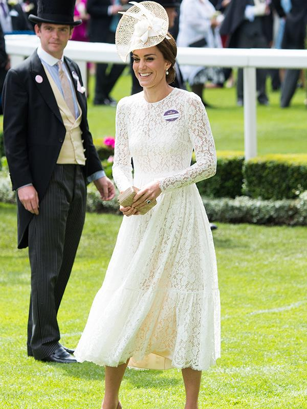 Kate loves wearing white lace to the races, and why not when it looks so stunning! Here she is having a laugh in 2016.